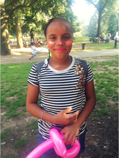 Rainbow clown face painting and balloons