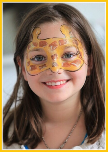 Giraffe face painting by Kiki
