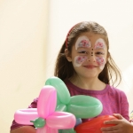 Butterfly face painting and flower balloon NYC event