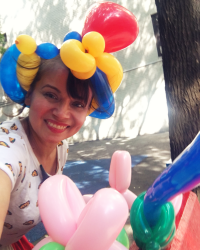 Cute balloon artist by Kiki's Faces and Balloons