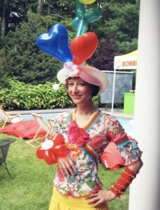 Photo of a female balloon artist clown at kids party event nyc
